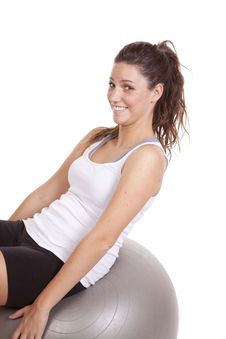 Woman Leaning Back On Fitness Ball Royalty Free Stock Images