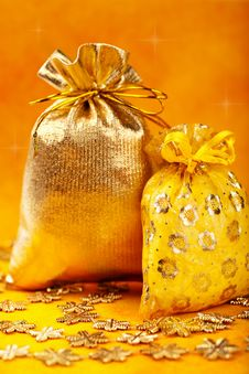 Free Golden Christmas Gift Sacks And Golden Snowflake Royalty Free Stock Images - 16906509