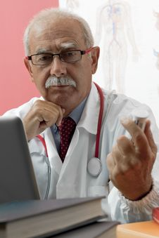 Free Senior Doctor Using Webcam Royalty Free Stock Images - 16906769