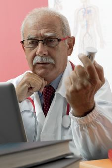 Free Senior Doctor Using Webcam Royalty Free Stock Photography - 16906817