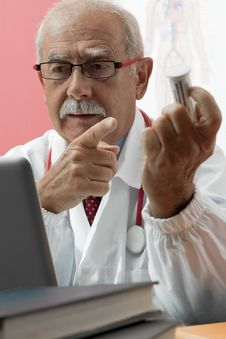 Free Senior Doctor Using Webcam Stock Photography - 16906882