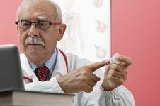 Free Senior Doctor Using Webcam Stock Image - 16907031