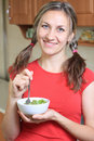 Free Portrait Of Young Happy Woman Eating Salad At Home Stock Image - 16919141