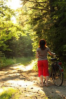 Bicyclist Woman Walk In The Park With Bikes Royalty Free Stock Images