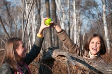 Free Two Young Beautiful Women Playing With Apple Stock Images - 16910764