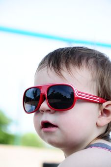 Free Little Girl Wearing Sunglasses Stock Photo - 16916690