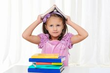Free Little Girl Is Studying Literature Royalty Free Stock Images - 16917039