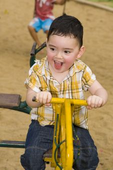 Free Cute Boy On A Carousel Royalty Free Stock Images - 16917729