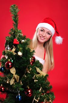 Young Girl Dressed As Santa Claus Royalty Free Stock Images
