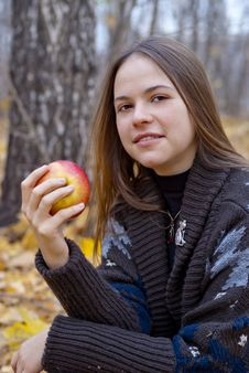 Free Portrait Of Brown-haired Girl With Apple Royalty Free Stock Image - 16917876