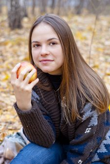 Portrait Of Brown-haired Girl With Apple Royalty Free Stock Photo