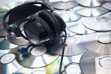 Free CDs Background And Headphones Royalty Free Stock Image - 16918426