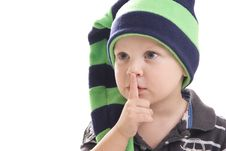 Child In A Green Cap On A White Background Royalty Free Stock Photos