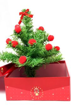 Red Gift Box And Christmas Tree Royalty Free Stock Image