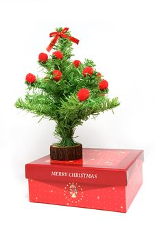 Red Gift Box And Christmas Tree Royalty Free Stock Photo