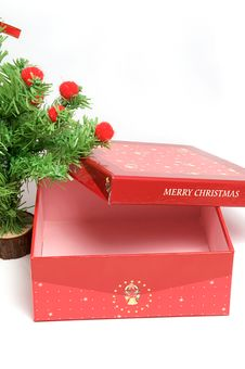 Red Gift Box And Christmas Tree Stock Photos