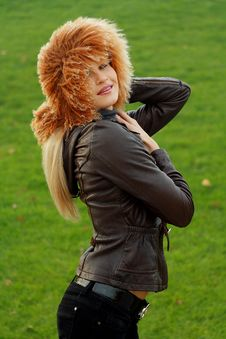 Free Beautiful Blonde In Brown Jacket Royalty Free Stock Photography - 16921437