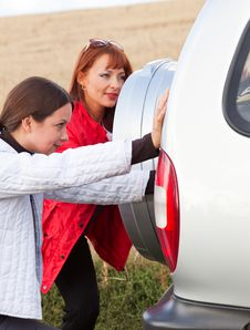 Free The Car Is Pushed By Women Royalty Free Stock Photo - 16921505