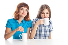 Free Two Teen-girls Are Drinking Tea Stock Photos - 16921753
