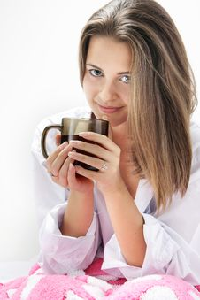 Free Young Girl With Cup Of Tea In Bed Royalty Free Stock Photos - 16929038