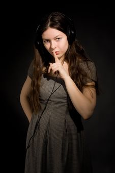 Free Girl In Headphones Listening Music Royalty Free Stock Photography - 16929297