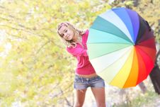 Free Happy Girl With Colorful Umbrella Stock Photo - 16929410