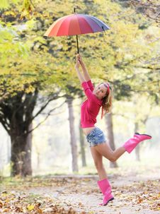 Free Happy Girl With Colorful Umbrella Royalty Free Stock Image - 16929426