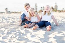 Young Sisters And Brother Having Fun At The Bea Royalty Free Stock Images