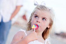 Free Little Girl Enjoying Her Lollipop Royalty Free Stock Photography - 16930247