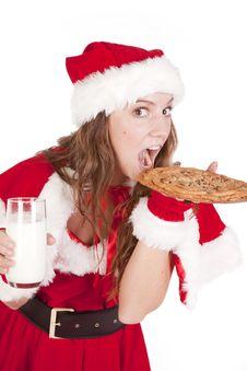 Free Mrs Santa Eating Big Cookie Stock Photography - 16930492