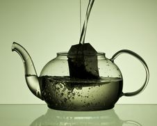 Free Pouring Water Into Teapot With Teabag Royalty Free Stock Photography - 16932047