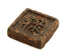 Free Pressed Briquette Of Tea With Hieroglyphic Stock Images - 16935004