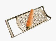 Carrots Lie On A Grater Royalty Free Stock Images