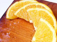 Orange On Wood Board Stock Photos