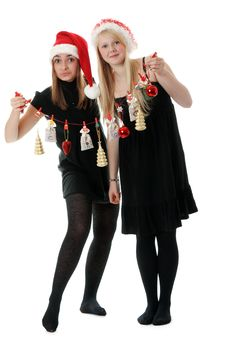 Free Two Girls In Hat Santa With Festoon Royalty Free Stock Image - 16943616