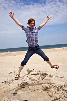 Free Boy Enjoys  The Beautiful Beach And Jumps Royalty Free Stock Photo - 16943635
