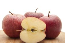 Halved Apple On Edge Board Royalty Free Stock Images