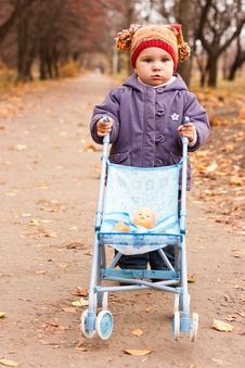 Beautiful Baby With A Stroller Stock Photography