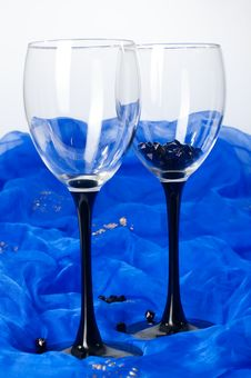 Free Two Glasses With Beads On Blue Textile Stock Photos - 16946053