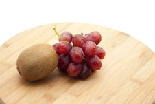 Red Grapes With Kiwi Stock Photography