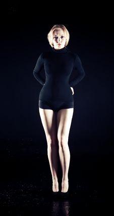 Free Blonde Girl In Dark Studio Stock Photography - 16950482