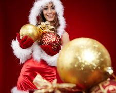 Free Woman With Christmas Present Royalty Free Stock Images - 16951359