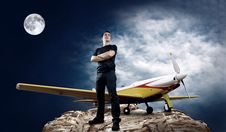 Free Man And Airplane Royalty Free Stock Photos - 16953008