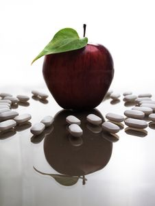Free Mutant Apple And Pills Royalty Free Stock Image - 16955646