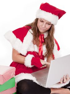 Free Mrs Santa Pointing At Computer With A Scowl Royalty Free Stock Images - 16955679