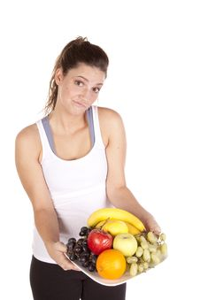 Free Woman In White Tank Top Not Sure About Fruit Royalty Free Stock Photography - 16955917