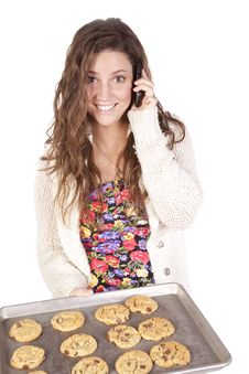 Woman On Phone Just Made Cookies Stock Images