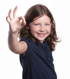 Free Little Girl Gives O.K. Sign Stock Image - 16959311