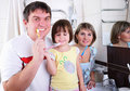 Free Mom, Daughter And Father Brush Their Teeth Royalty Free Stock Photography - 16962857
