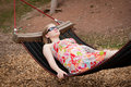 Free Woman Relaxing In Hammock In Park Royalty Free Stock Photos - 16964728